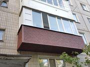 Обшивка балкона сайдингом.